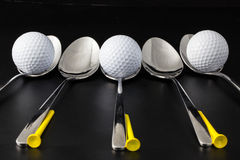 Spoons and golf balls Royalty Free Stock Image