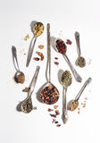 Spoons with herbal tea Stock Photography