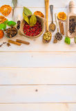 Spoons with herbs and spices. Collection of herbs and spices on a wooden background with space for text royalty free stock photos