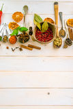 Spoons with herbs and spices. Collection of herbs and spices on a wooden background with space for text royalty free stock photography