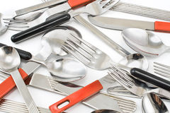 Spoons, knifes and forks. In a row Royalty Free Stock Photos