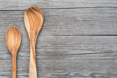 Spoons of olive wood on grey table Stock Photo