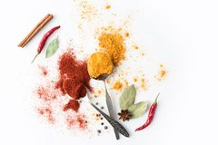 Spoons with paprika and curry Stock Photo