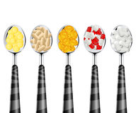 Spoons of pills Stock Images