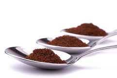 Spoons with powdered coffee Royalty Free Stock Photography