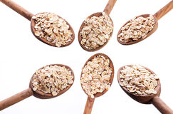 Spoons with rolled oats. Stock Photo