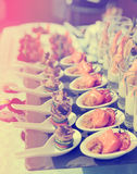 Spoons with seafood snacks, toned Royalty Free Stock Images