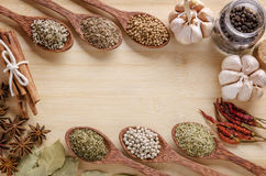 Spoons and spices on cutting board Stock Photo