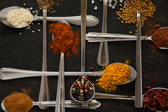 Spoons with spices Stock Photo