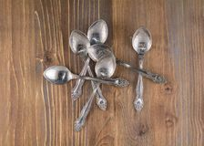 Spoons. Are scattered on the table Royalty Free Stock Photos