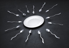 Spoons straggling to get to a plate Royalty Free Stock Photo
