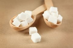 Spoons with sugar cubes, Stock Image