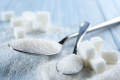 Spoons with sugar on table, Stock Photography