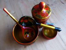 Spoons and tableware. Closeup. Khokhloma - an ancient Russian folk craft XVII century. Traditional elements Khokhloma Stock Image