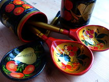 Spoons and tableware. Closeup. Khokhloma - an ancient Russian folk craft XVII century. Traditional elements Khokhloma Stock Image