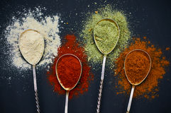 Spoons with various spices. On a dark background. Colorful mix of spice. Top view. Selective focus Stock Photo
