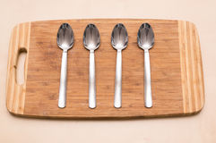 Spoons wooden board Stock Photography