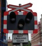 Spoor die Warnsign kruisen stock afbeeldingen