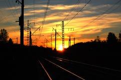 Spoorweg bij zonsondergang Royalty-vrije Stock Afbeeldingen