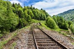Spoorweg in de bergen Stock Foto's