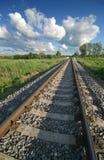 Spoorweg en wolken Stock Foto's