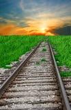 Spoorweg en zonsondergang stock foto