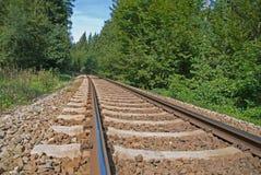 Spoorweg in platteland Stock Foto