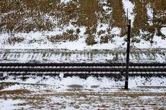 Spoorweg in sneeuw stock afbeeldingen