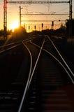 Spoorweg in Zonsondergang Stock Afbeeldingen