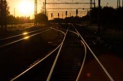 Spoorweg in Zonsondergang Stock Foto's