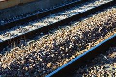 Spoorwegachtergrond en stenen stock afbeeldingen