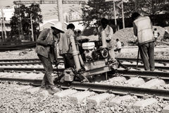 Spoorwegarbeiders, spooronderhoud Stock Foto's
