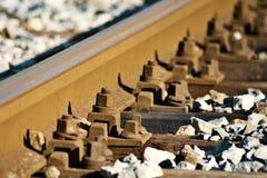 Spoorwegdetail bij zonsondergang Stock Foto