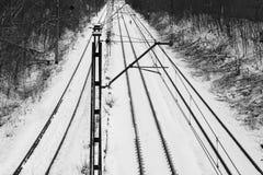 Spoorwegsporen in sneeuw Stock Afbeeldingen