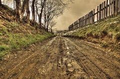 Sporcizia sulla strada rurale, hdr immagini stock