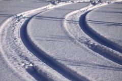 Sporen in de sneeuw Stock Foto