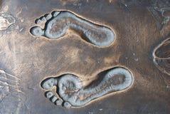 Sporen van de persoon op brons Royalty-vrije Stock Foto
