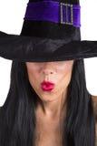 Sporgere le labbra sexy della strega Immagine Stock