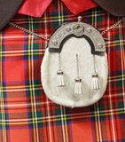 Sporran on a red kilt. A sporran on a red kilt worn by a scot Stock Photos