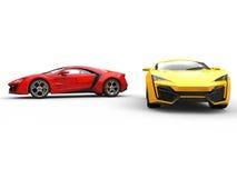 Sportów samochody - czerwień i kolor żółty zdjęcia royalty free