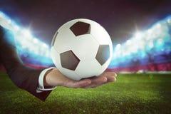 Sportów zakłady Piłki nożnej piłka na ręce biznesmen z stadium tłem Obraz Royalty Free
