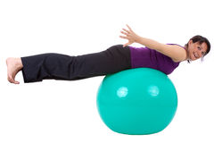 Sport. Young woman with a ball seat stock images
