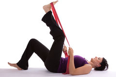 Sport. Exercises with a red Theraband Royalty Free Stock Photos