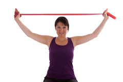 Sport. Exercises with a red Theraband stock photos