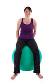 Sport. Young woman with a ball seat royalty free stock photos