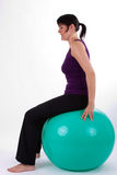 Sport. Young woman with a ball seat Royalty Free Stock Photography