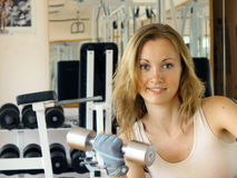 Sport. Nice girl at the gym stock photo