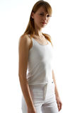 Sport. Young woman with white top and white pants Stock Image