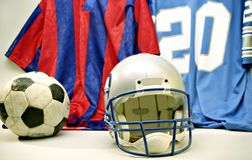 Sport. Soccer and football equipment both on display stock images