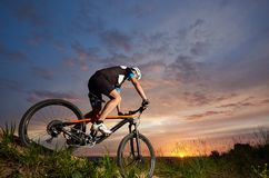 Sport activities at fresh air, athletic cyclist riding bike. stock photos